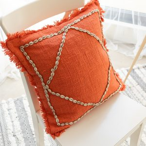 Soft cotton cushion cover with cowrie shells and fringe