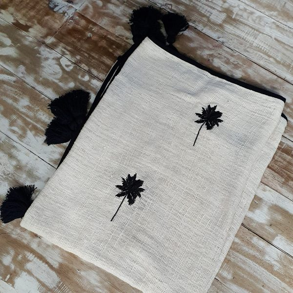 Soft cotton throw with tassels and palm tree embroidery