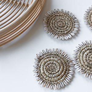 Raffia coaster with cowrie shells