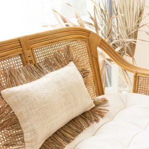 Linen cushion cover with raffia fringe